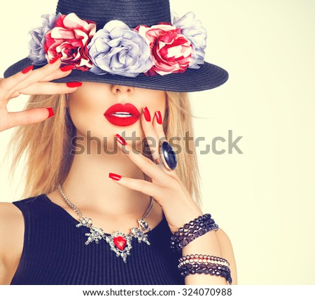 Stock Photo Beautiful sexy woman with red lips and manicure in modern black hat. Beauty fashion model girl with accessories- rings, bracelets, necklace and elegant hat decorated with flowers