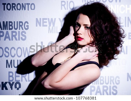 Beautiful sexy woman with red lips on dark background - stock photo