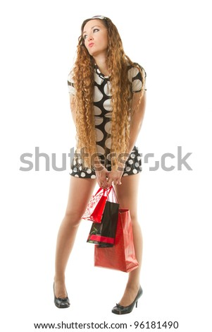 Beautiful sexy woman with shopping bags and long hair on white background. - stock photo