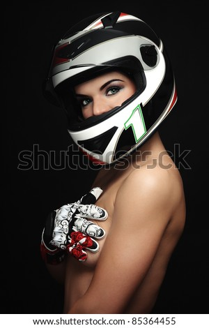 Beautiful sexy woman with stylish makeup in biker helmet and gloves