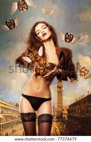 beautiful sexy woman with venetian mask in venice