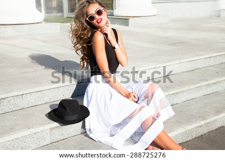 Beautiful sexy young business woman blond hair evening makeup wearing dress suit top skirt high heels shoes business clothes for meetings walks summer fall collection perfect body shape glasses hotel