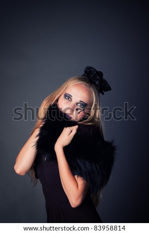 beautiful sexy young girl make up as a witch for Halloween