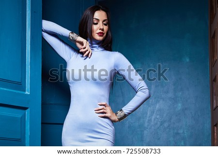 Beautiful sexy young woman brunette hair luxury chic wear casual style for date dress skinny blue color pretty face autumn collection glamor model fashion clothes interior room bag. - Shutterstock ID 725508733