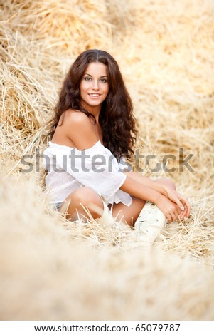 Beautiful sexy young woman in the hay