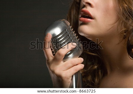 Beautiful sexy young woman singing