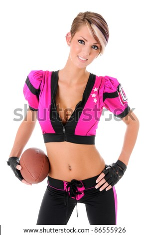 Beautiful sexy young woman wearing a pink American football Uniform for Breast Cancer Awareness holding a ball