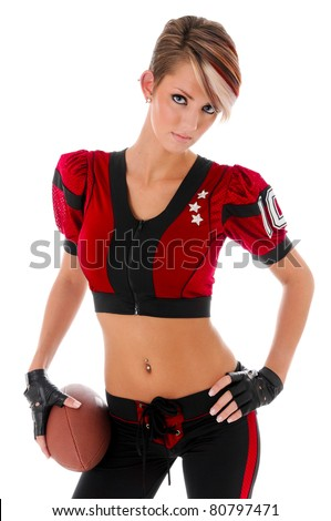 Beautiful sexy young woman wearing American football Uniform holding a ball - stock photo