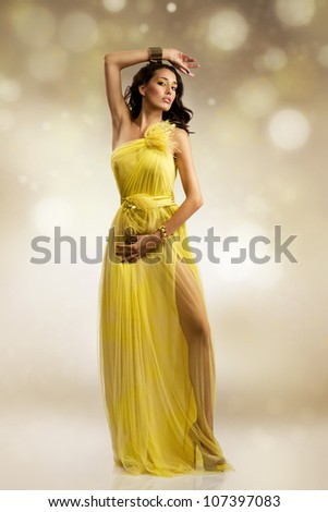 beautiful sexy young woman wearing yellow evening dress