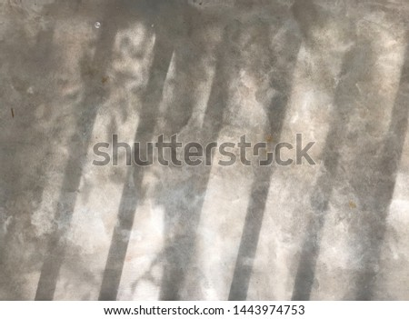 beautiful shadow from baluster bar and small tree leaves shine on gray cement in natural daylight, using for background #1443974753