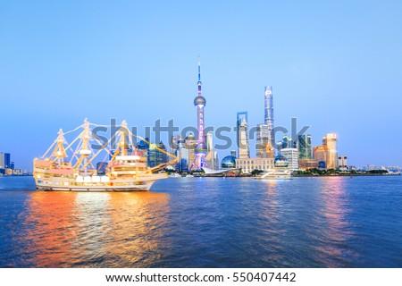 Beautiful Shanghai skyline at night,modern urban background #550407442