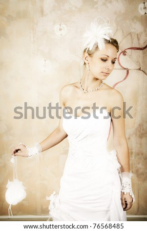 shapely bride in an elegant wedding dress on a colored background