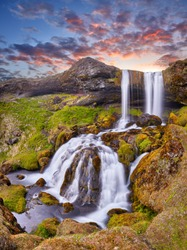 Beautiful Sheep's Waterfall. Famous tourist landscape. Travel concept background. Dramatic summer sunrise, Iceland, Atlantic Ocean, Europe. Travel postcard. Incredible sunrise. Amazing landscape.
