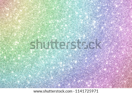 beautiful shiny multi-colored background of sequins and bokeh