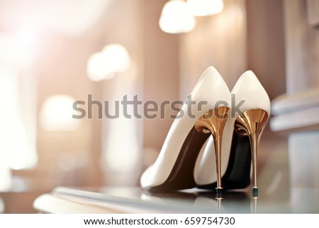 beautiful shoes for the bride on a high steel heels #659754730