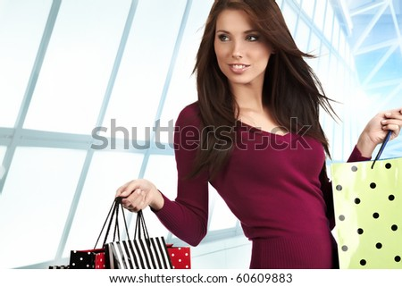 Beautiful shopping woman at a draw mall