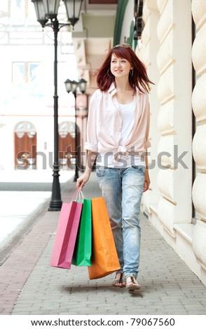 Beautiful shopping woman in mall