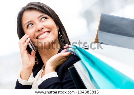Beautiful shopping woman talking on her cell phone