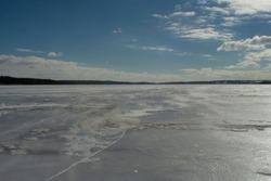 Beautiful shore of a frozen river in winter