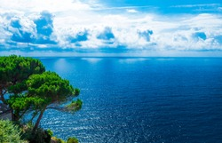 Beautiful shore of the Adriatic Sea. Bay view with  white clouds.