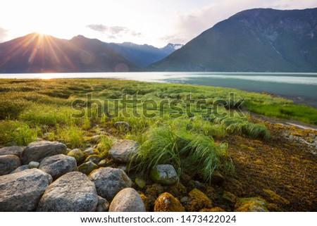 Beautiful shoreline at sunset in Bella Coola, Canada