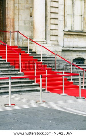 Beautiful shot of red carpet stairs awaiting vip, celebrities or government officials for a celebration or special  event.
