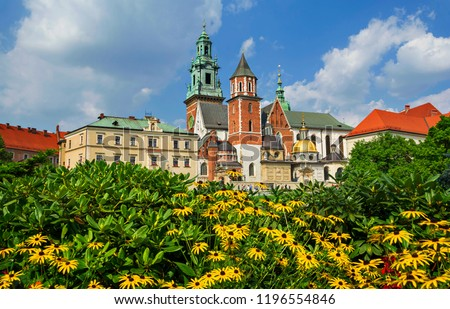 Beautiful sightseeing with Wawel Royal Castle and colorful flowers in Krakow, Poland #1196554846