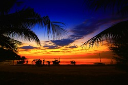 Beautiful Silhouette coconut palm tree on the tropical beach and sea with sunset time. sunset on the beach Takamaka, Mahe island, Seychelles.caribbean and hawaii. Koh Tao