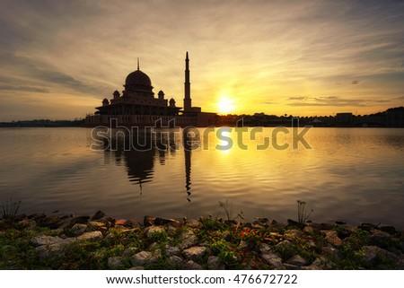 Beautiful silhouette of Putra Mosque, Putrajaya Malaysia at sunrise. #476672722