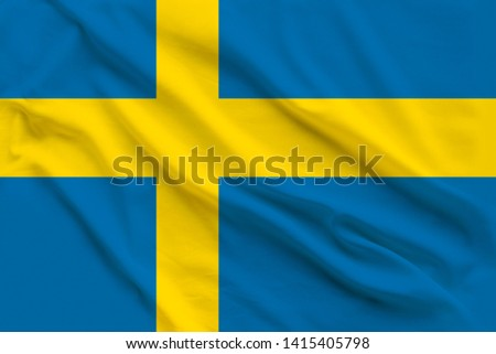 Beautiful silk flag of Sweden with soft folds in the wind #1415405798