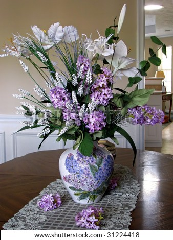 beautiful silk lilac floral arrangement as table centerpiece