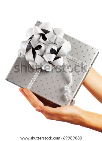 Beautiful silver gift box with female hands isolated on white background