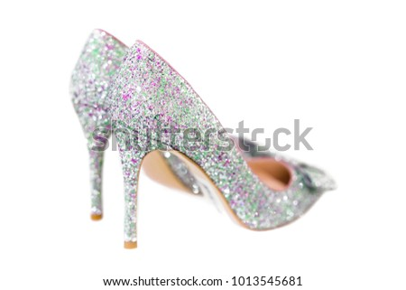 b70bbde688 Beautiful silver glitter high heel female shoes isolated on white. Wedding  accessories . Cinderella shoes