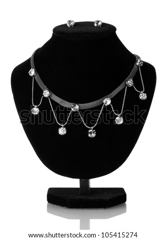 beautiful silver necklace  and earrings on mannequin isolated on white