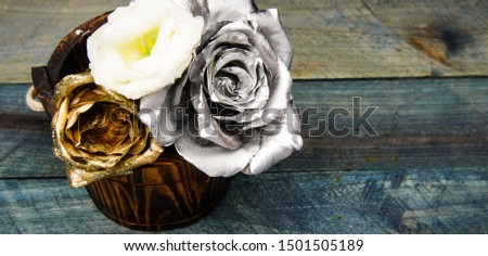 Beautiful silver rose. Floral shop. Metallic steel color. Metal flowers. Eternal beauty. Rose flowers. Fashion and beauty. Flowers covered metallic paint close up. Stylish bouquet. Botany concept.