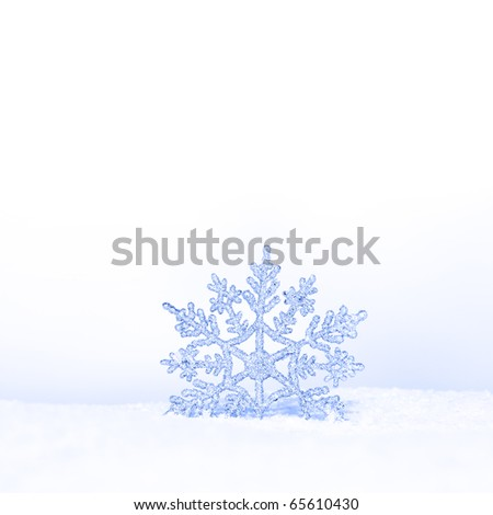 beautiful silver snowflake in snow - stock photo