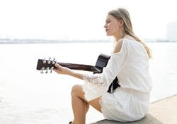 Beautiful singer songwriter with her guitar
