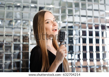 Old woman singing karaoke Images and Stock Photos - Page: 16