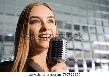 Beautiful Singing Girl. Beauty Woman with Microphone. Glamour Model Singer. Karaoke song #797599192