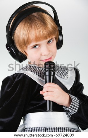 Beautiful singing girl with microphone  on white background