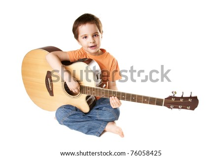 Beautiful singing little boy with acoustic guitar isolated on white background