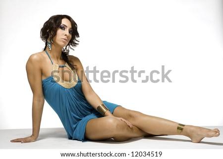beautiful sitting lady wearing blue Greek style dress