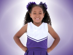 Beautiful Six Year Old Cheerleader In Purple And White.