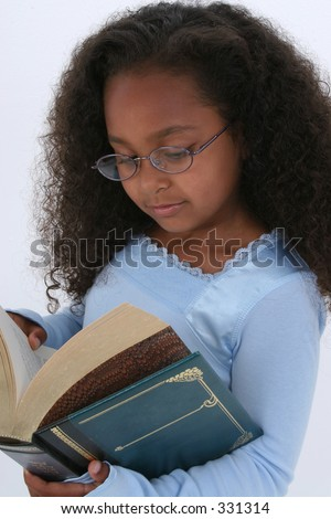 Beautiful Six Year Old In Glasses Readign Large Book.