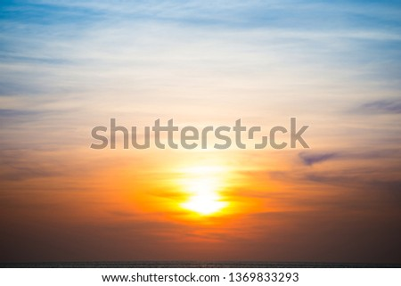 Beautiful sky and clouds with orange dramatic sunset. Can be used as abstract or nature background #1369833293