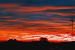 Beautiful sky behind the dark silhouettes of the horizon