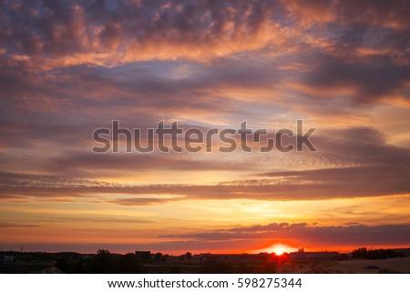 Beautiful sky during sunrise. Fiery orange sunset.