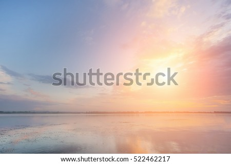 Beautiful sky over the river at sunset or sunrise #522462217