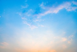 Beautiful sky with cloud before sunset. Colorful sky in twilight background. Bright Blue, Orange And Yellow Colors Sunset.