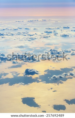 Beautiful sky with clouds, a view from an aeroplane above the clouds #257692489